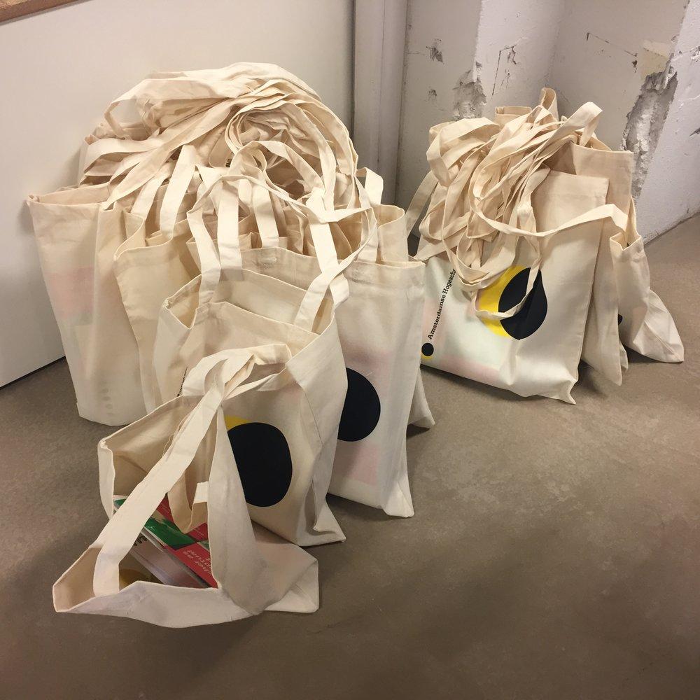 Preparing bags for the symposium