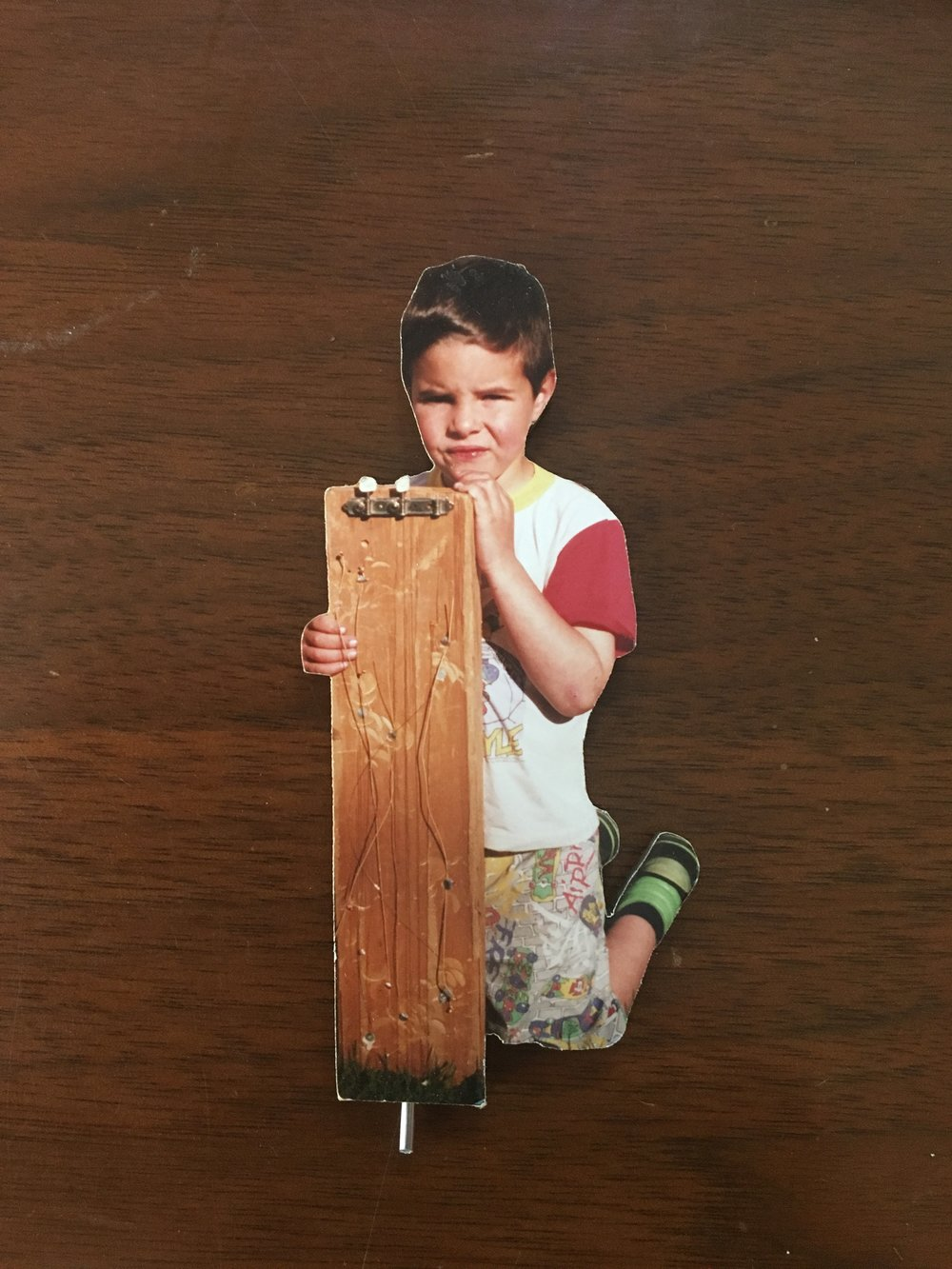 David's firstborn and the business' namesake clutching his own creation made out of a block of cedar for guitar tops. The young Morgan added tuners and nails himself to hold the strings down.