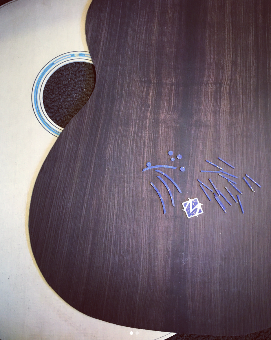 OM style guitar with lapis lazuli stone inlay ornamentation- rosette ring, logo interior parts, fingerboard dots and a lapis bound top.