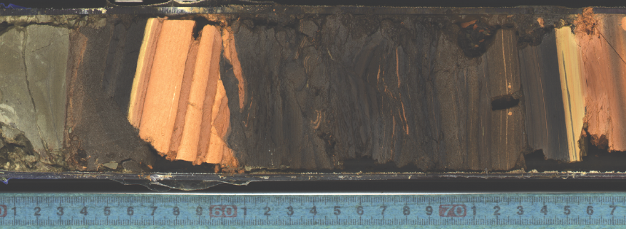 Faulted material at the bottom of the JFAST core. This fault was thought to be a depositional unconformity. However, trace element stratigraphy which implies a significant age gap in this section of the core. In addition, biomarkers measured on surrounding samples indicate significant heating at this location. These two lines of evidence both suggest a significant fault here, thought to line up with the layer of crushed material between the green-ish mudstone (left) and the darker pelagic clay (right).