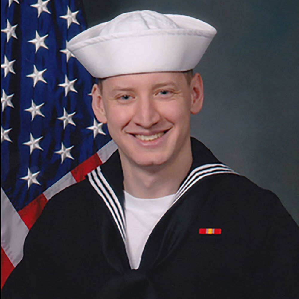 John Larimer - John Larimer, 27, was a Navy Petty Officer 3rd Class and cryptologic technician with high-level clearance who was helping to protect America. He had been stationed at the U.S.Fleet Cyber Command at Buckley Air Force Base in Aurora for only about a year before his heroic act. He was murdered protecting his girlfriend and friend inside the Aurora theater during the mass shooting, jumping into action to protect them once the shooting began.John was the youngest of five siblings from Crystal Lake, Il.