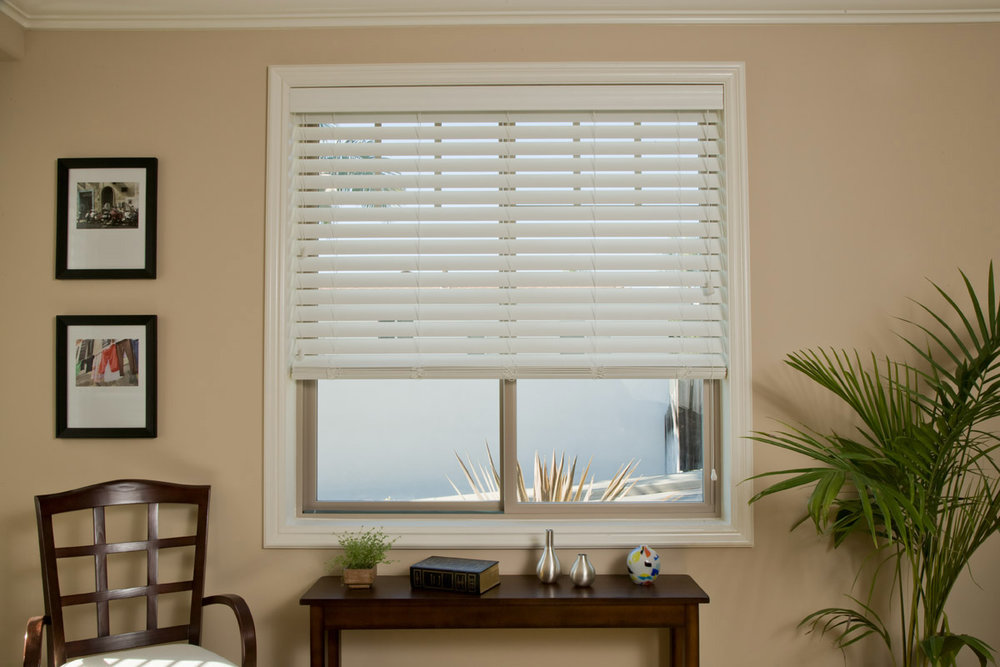 Faux Wood Blinds -  Achieve the look of traditional wood blinds with faux wood, manufactured with a sturdy composite wood core. The wood core and a UV inhibitor produce a strong, durable blind which virtually eliminates fading, peeling, cracking, and warping. These features make it an exceptional choice in high humidity areas like a bathroom or over a kitchen sink.