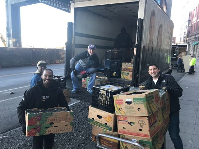 @amazon volunteers helping unload food donations from @foodlifeline!