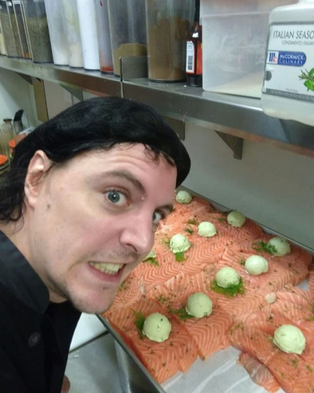 Chef Eric Bacon, his Art Deco of Pesto on Salmon. Thank you for smiling😬  @smashiesmashie #foodrescue #nonprofit #seattle #westlake #hotmealprogram #salmon #food