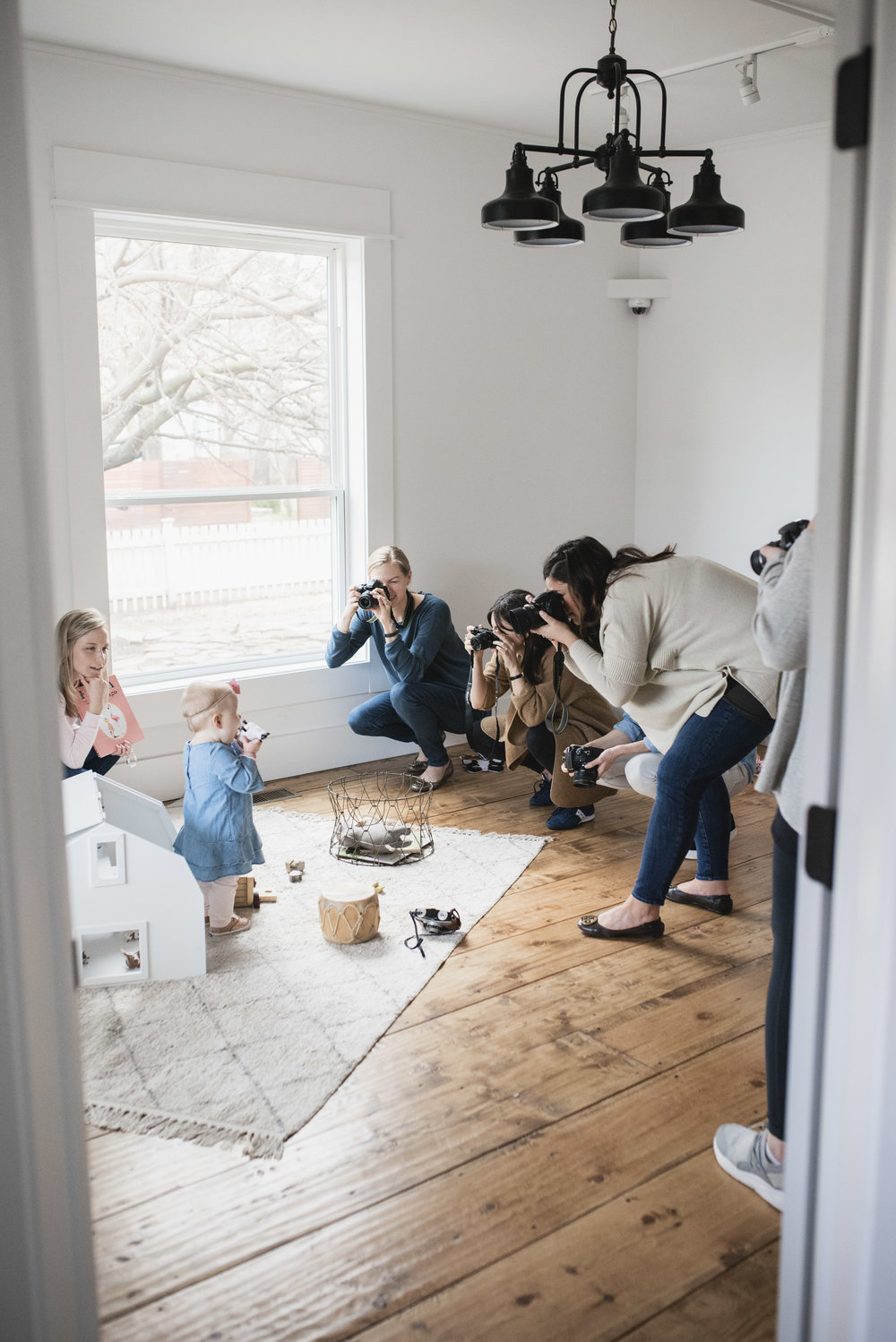 Moms and beginners practicing manual mode photography with the help of a professional photographer at  Kindred Photography Workshops , Photo by  Hazel and Haze Photography