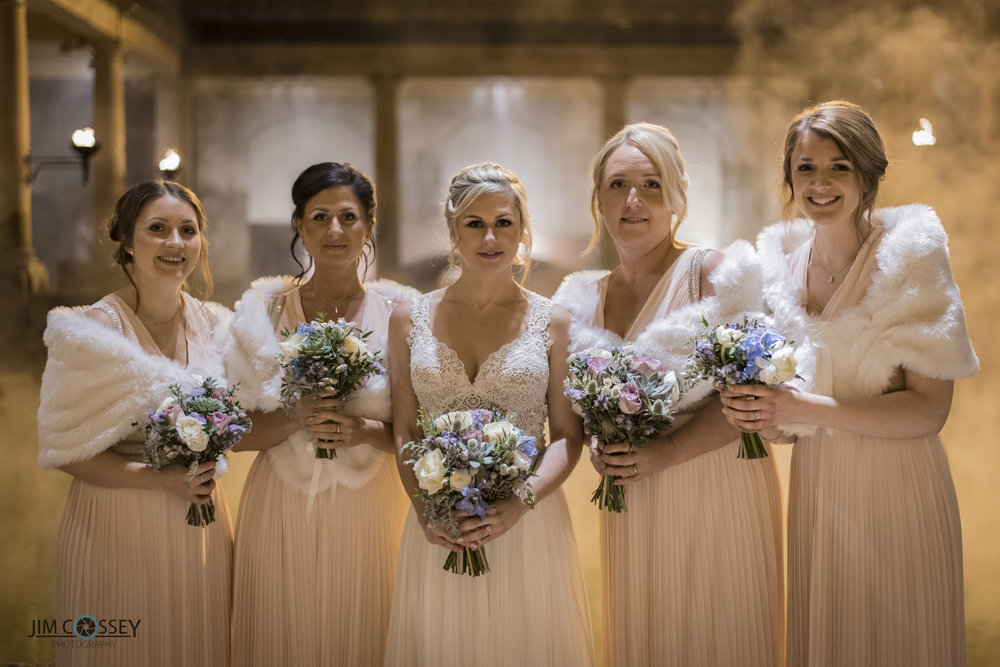 Becky and her bridesmaids looked beautiful with their furry shrugs and stunning floral bouquets.