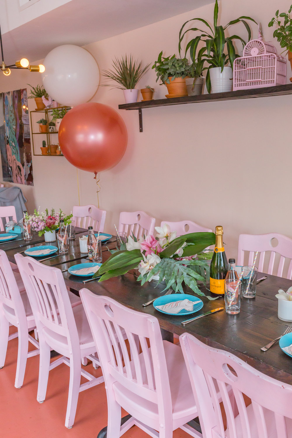 Summer tablescape with pink chairs