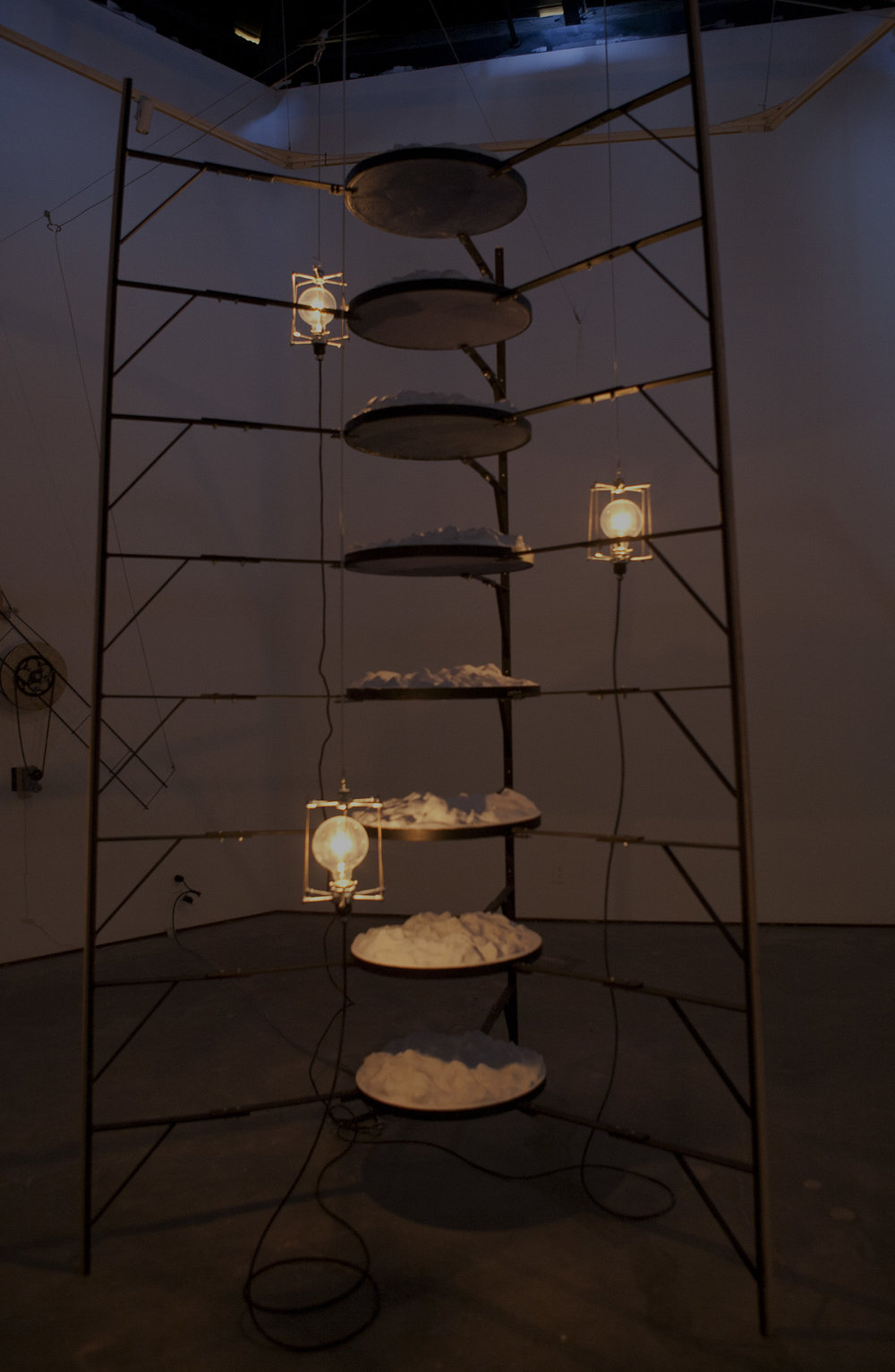 Steel, plaster, paraffin wax, birch plywood, cement, glass, paint, hardware, variable speed dc motors, incandescent bulbs. 2012.