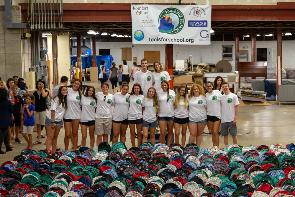 Some members of the 2017-2018 Tools for School teen board at our 2018 Packing Event on August 19, 2018