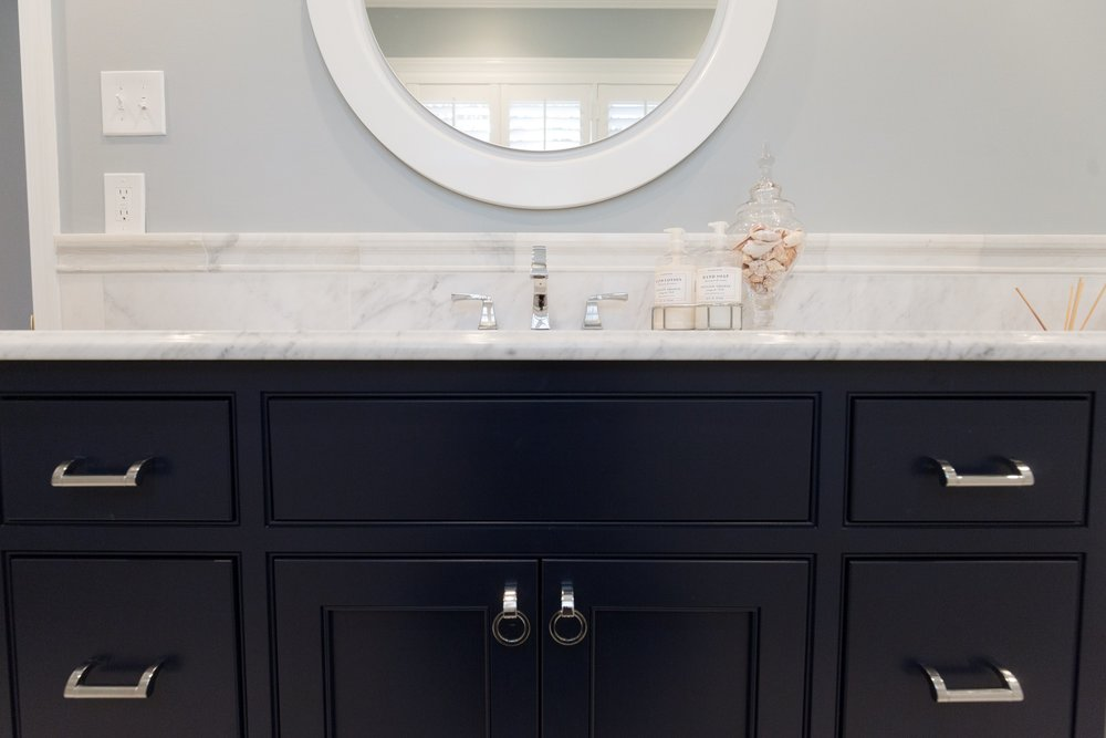 The Ring Project - Classic, fresh, and sophisticated. We replaced this dated 1960's bathroom and brought it into the 21st century with design elements such as marble hexagon, bright white hues paired alongside classic blues, and sleek fixtures. All design selections to make a happy home for this sweet couple.