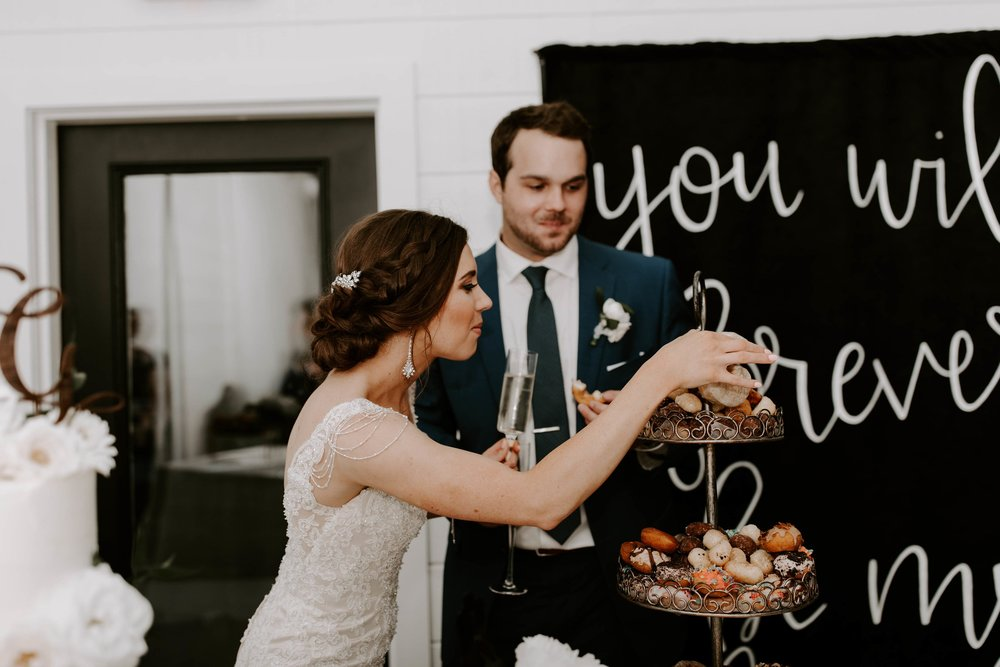 cutting cake and grabbing a donut-min.jpg