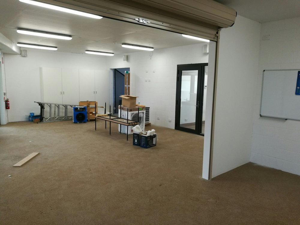 This photo shows the gym area that will soon be fitted out, and the doors to the physiotherapy room and the recovery room. The latter includes an ice bath and a hot spa.