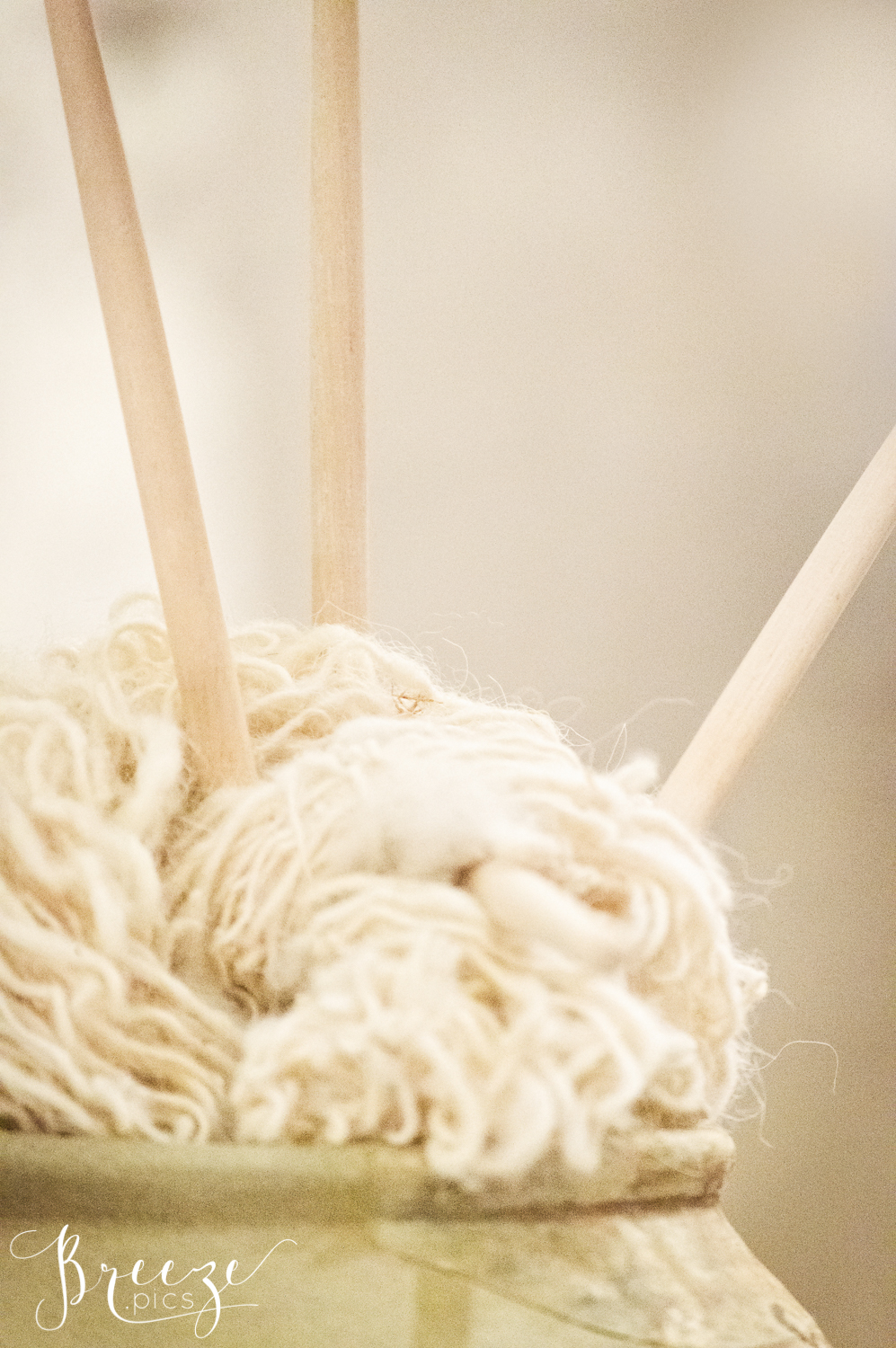 hand spun wool with wooden knitting needles Bernadette Meyers craft photography