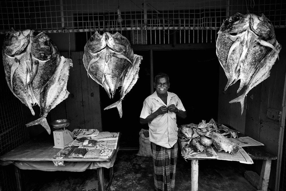 Dried fish vendor, Jaffna, Sri Lanka.