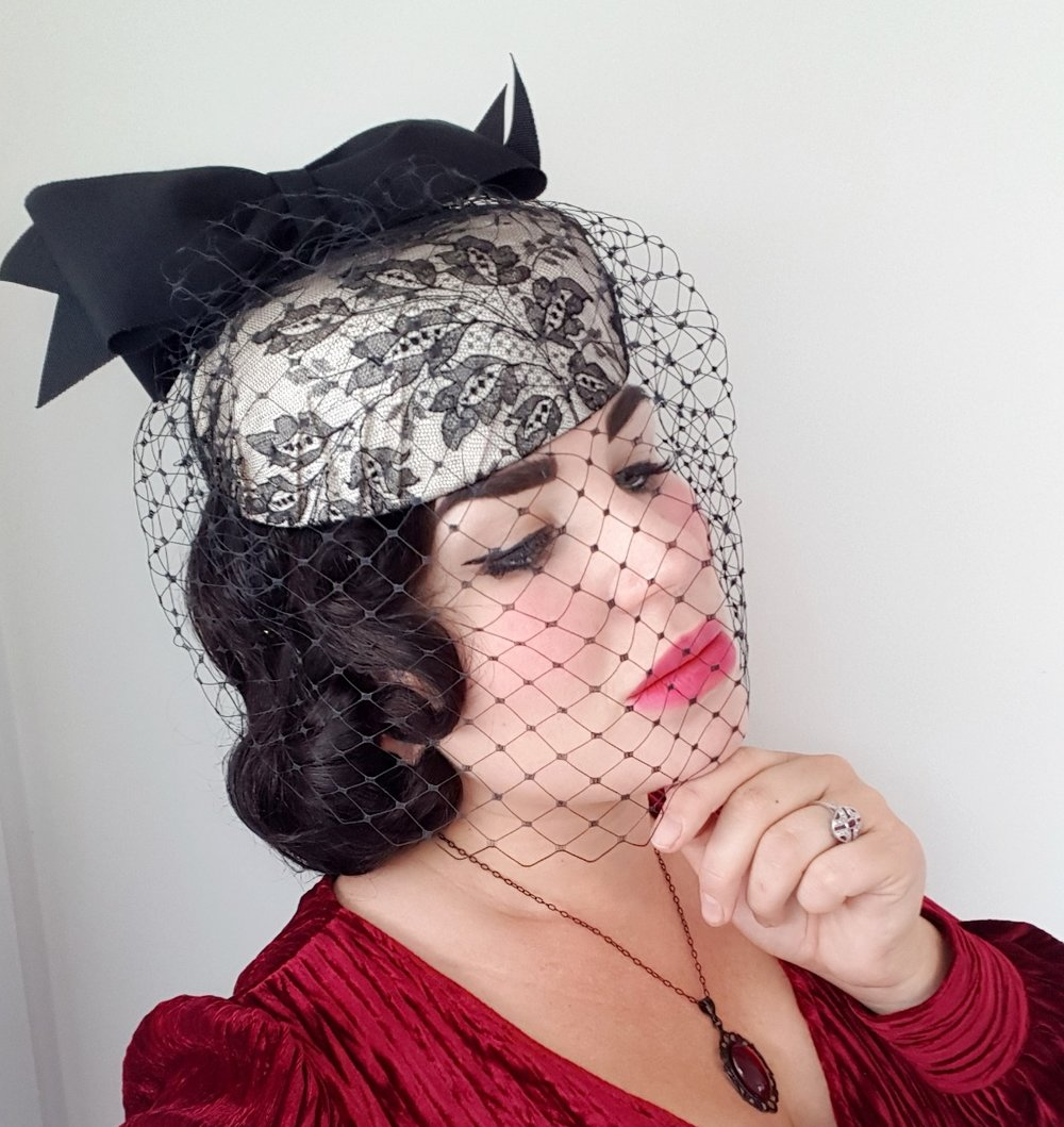 This type of veiled hat was extremely popular as ladies dressed up simple outfits with exquisite hats. This hat is made by designer    Abigail Aldridge    who you may recall me writing about    here   .