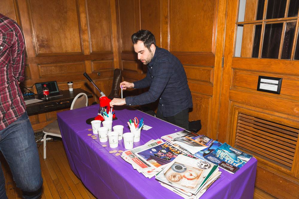 Ryan Brodsky's free custom button-making station at Moon Jam, January 2018. Photo by Travis Emery Hackett.