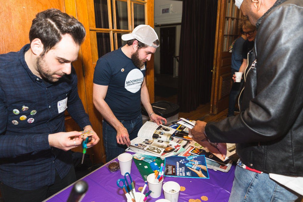 Moon Jam volunteers, Ryan Brodsky and Joe Romanini at the custom-button making station.