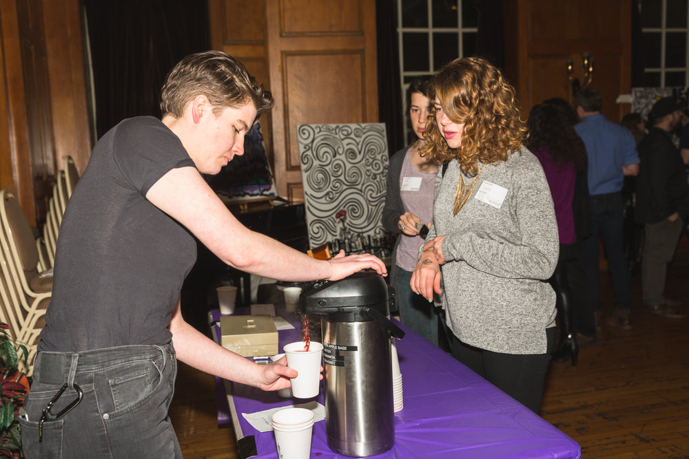 Moon Jam volunteer, Ariane Powell, preparing 'Moon Juice' at the donation bar!