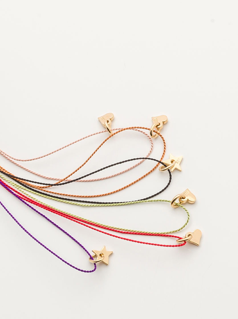 ATELIER SIMPLE necklaces & bracelets   - ADJUSTABLE SILK CORD BRACELETS AND NECKLACES WITH A LITTLE HEART OR STAR PENDANT IN 18 CARAT GOLDPLATED. THE ATELIER LINE IS HAND MADE IN OUR ATELIER IN GERMANY