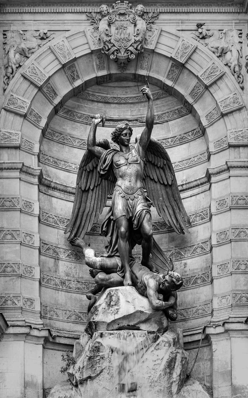This must be St. Michel stomping on the devil; part of the Fontaine St. Michel