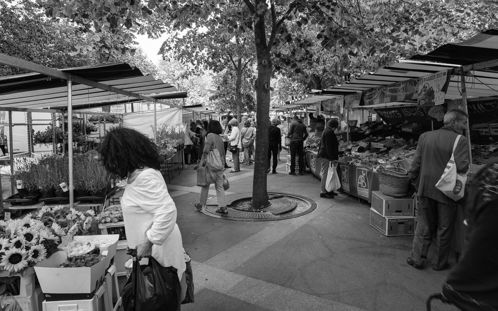 Shopping for flowers and vegetables; the residents of Paris' 19th arrondissement