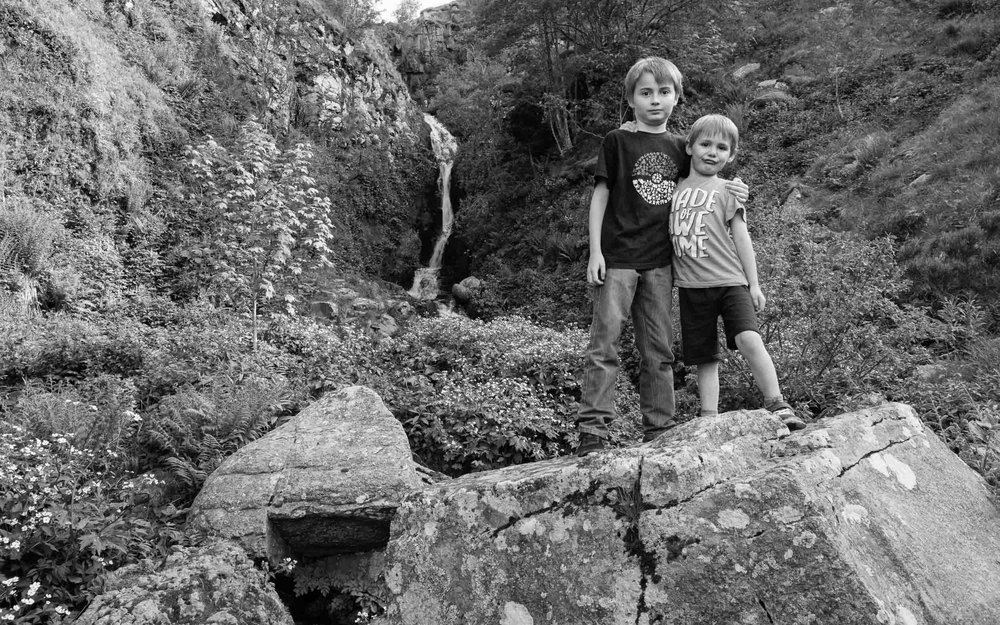 Ethan & Romain clambering on rocks