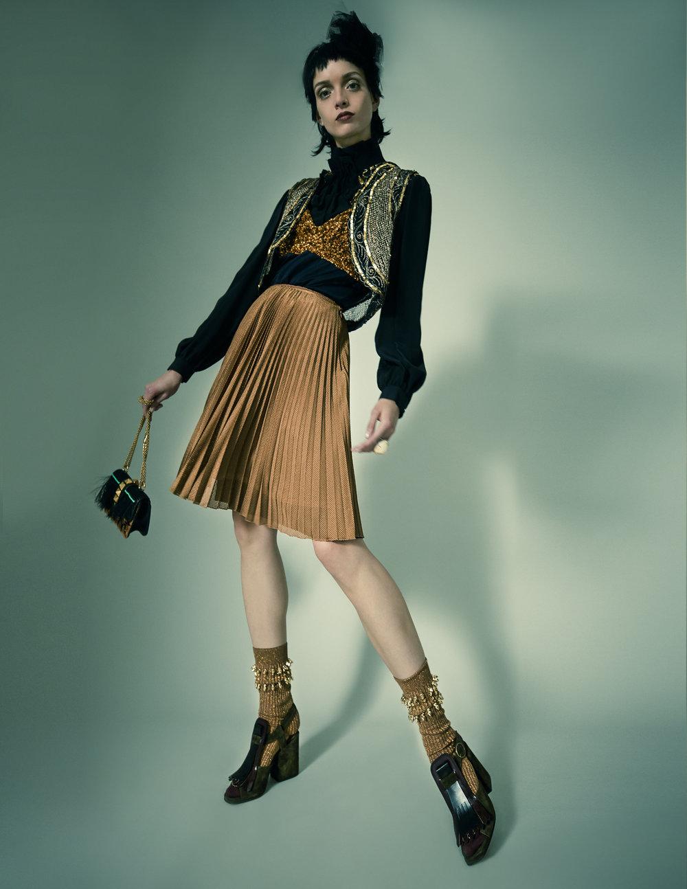 Skirt – PradaShirt – Dega Dress – Dries Van Noten Gilet – Laurence Bras Bag – Valentino Ring – Alexander McQueen Headpiece – Lanvin Socks – Benedict