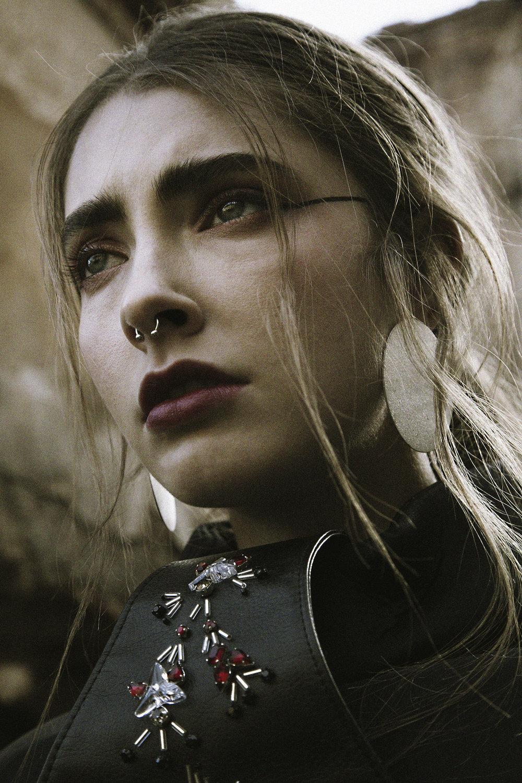 Jessica / Top: Simone Battista. Earrings: H&M.