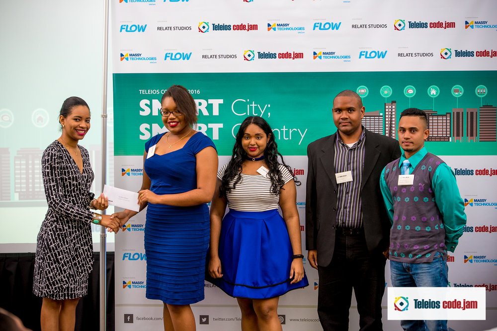 2ND PLACE WINNERS TEAM KONNECTICS (SBCS) WERE PRESENTED WITH THEIR PRIZE BY NICOLA MARIE MCCLEAN (MASSY TECHNOLOGIES INFOCOM )