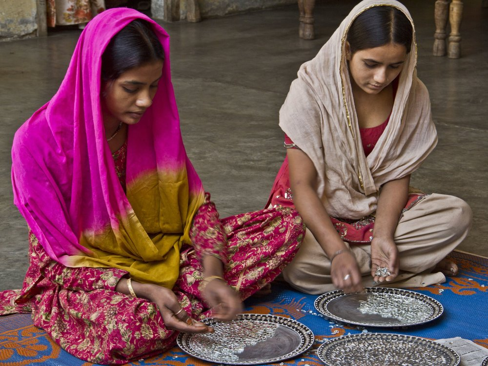 Women from Noah's Ark , India, making decorative plates