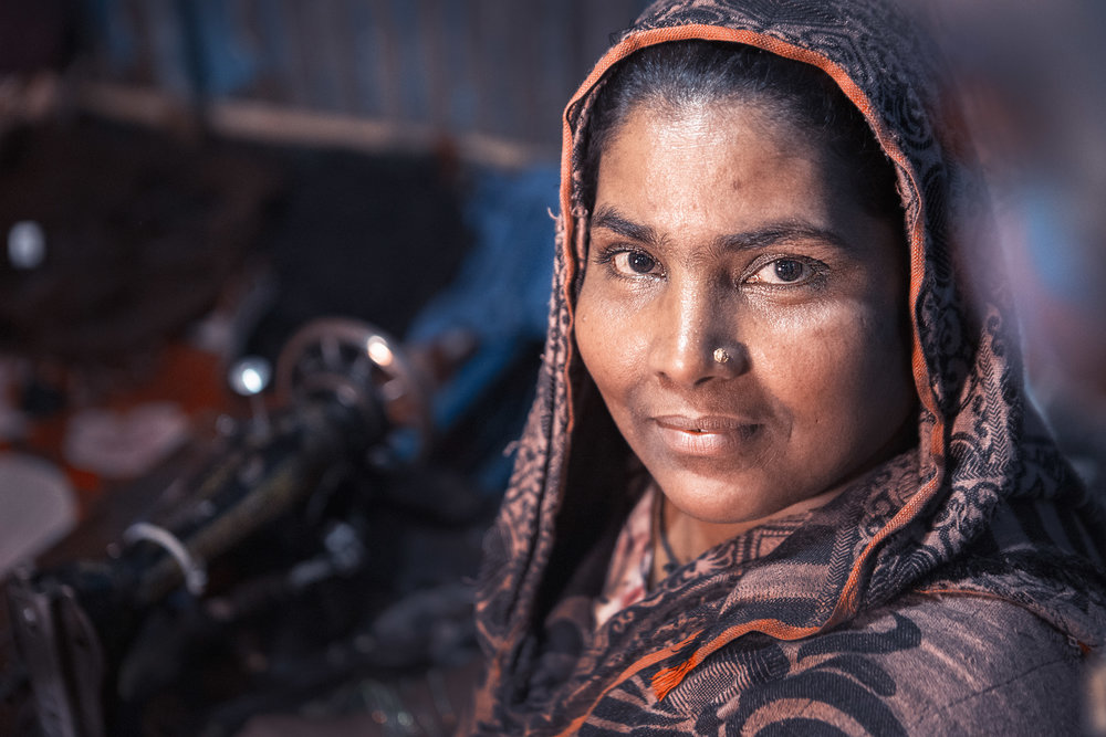 - Garment worker Shakila at home with her sewing machine Credit: Traidcraft Exchange/GMB Akash