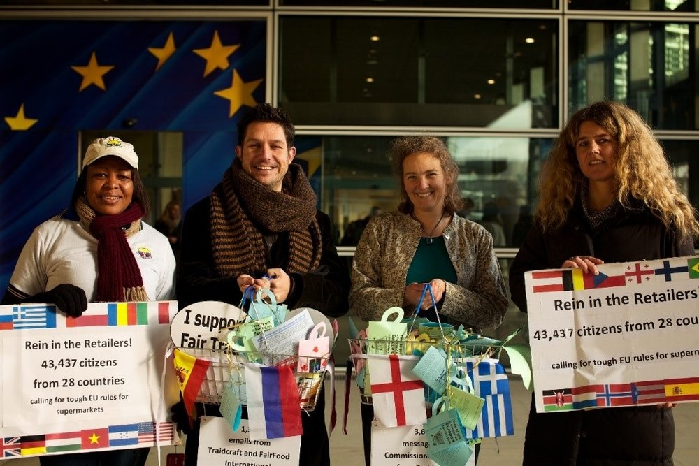 Campaigners including Traidcraft Exchange's Fiona Gooch (second from right) hand in a petition to the European Commission calling for tougher EU rules on supermarkets. Credit: Traidcraft Exchange