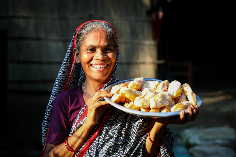 Shufia Begum took part in our project with women jute workers in Bangladesh. She stands with home-made snacks to sell in her shop. Credit: Traidcraft Exchange/GMB Akash