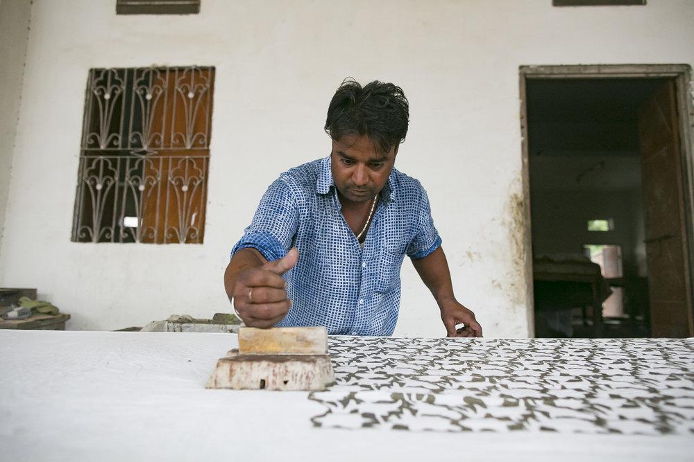 - Govind hand-printing textiles in his shop in Jaipur.Credit: Traidcraft Exchange/Allison Joyce
