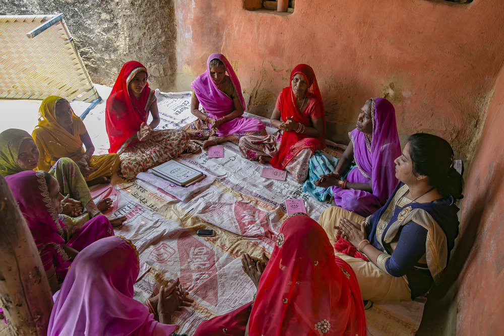 Women participate in a meeting in Udaipur, India. Credit: Traidcraft Exchange/Allison Joyce