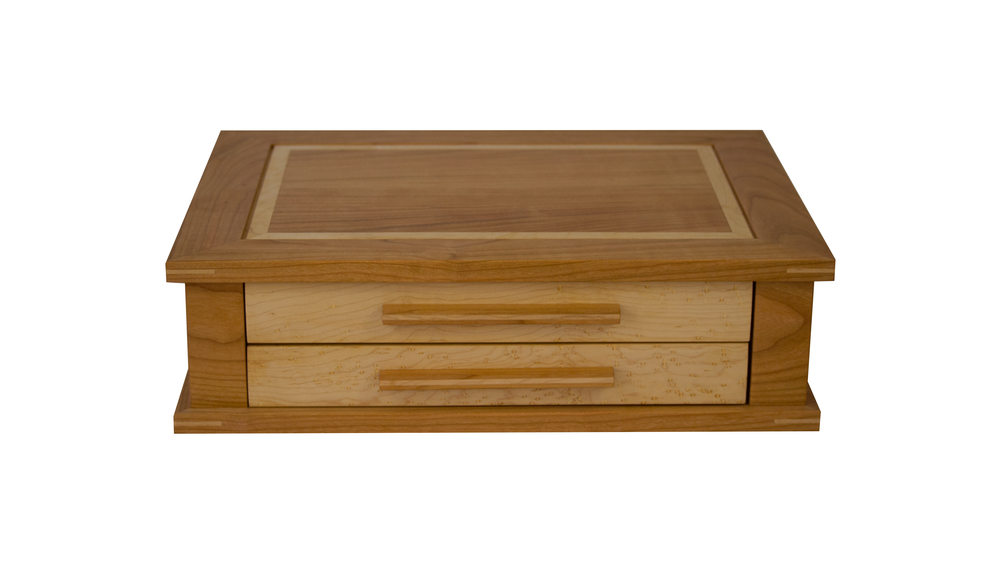 watch box JC - Available with 1, 2 or 3 velvet-lined drawers. Non-operating lid. Can house 12-24 watches depending on the configuration you choose.As shown: Cherry and Bird's Eye MapleDimensions: 17W x 13D x 7H (3-drawer)Price: from $279