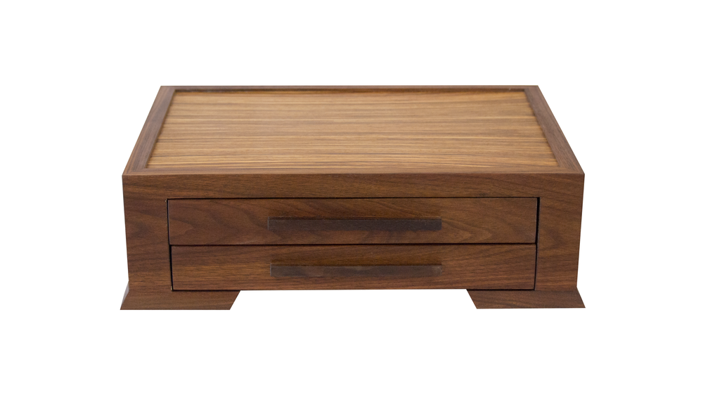 watch box VC - Available with 1 or 2 velvet-lined drawers.Can house 8-16 watches depending on the configuration you choose.As shown: Walnut and ZebrawoodDimensions: 17W x 13D x x 5H (2-drawer)Price: from $279