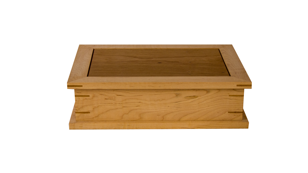 keepsake box - Sized to accommodate 8 1/2 x11 sheets of paper. Includes either a half-size sliding tray or a full-size removable tray. Can be resized.As shown: Curly Maple and CherryDimensions: 15W x 12D x 4 1/2HPrice: from $299