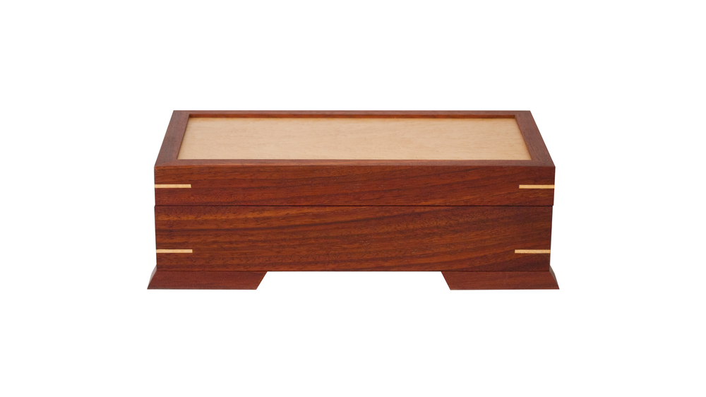 valet case - Available with either a half-size sliding tray or a full-size removable tray - perfect for keys and wallets. Lid panel and interior base are of the same wood (bird's eye maple as shown here).As shown: Padauk and Curly MapleDimensions: 14W x 7D x 5HPrice: from $279