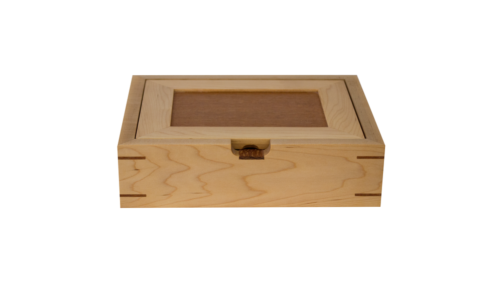 catch all - Ideal for counters, dressers and desks. Can be resized. Lid panel and base are of the same wood (lacewood as shown here).As shown: Curly Maple and LacewoodDimensions: 12W x 10D x 3HPrice: from $189