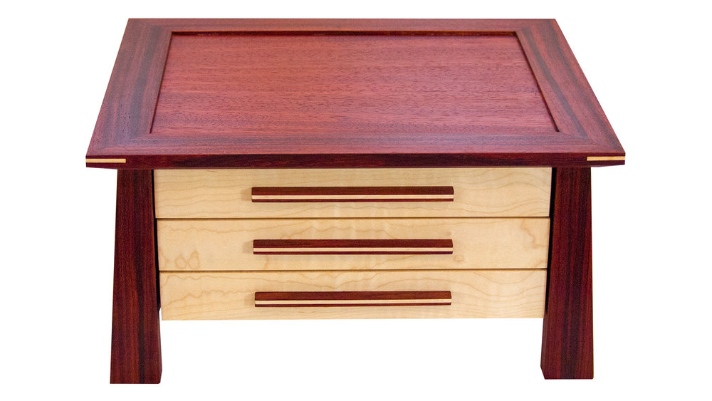 aja jewelry chest - Three velvet-lined drawers. Choose the divider options that best accommodate your needs. 260 square inches of storage space.As shown: Walnut and CherryDimensions: 15W x 13D x 8HPrice: from $489