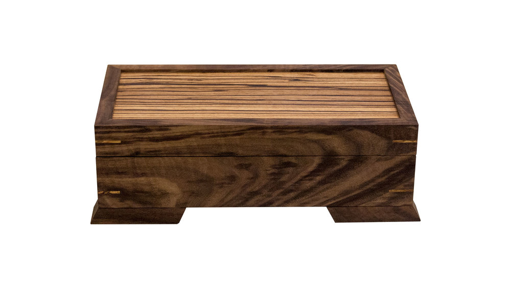 valet case - Available with either a half-size or a full-size removable tray - perfect for keys and wallets. Lid panel, interior base and tray base are of the same wood (zebrawood as shown here).As shown: Walnut and ZebrawoodDimensions: 15W x 8D x 5HPrice: from $259