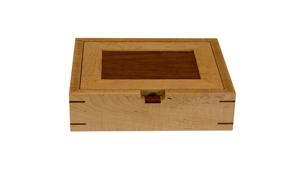 catch all - Ideal for counters, dressers and desks. Lid panel and base are of the same wood (bubinga as shown here). Overall dimensions can be resized.As shown: Curly Maple and BubingaDimensions: 12W x 10D x 3HPrice: from $189