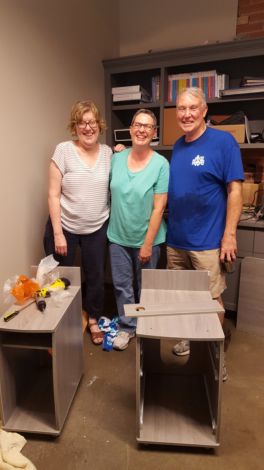 Building our new desks.  From left to right: Claudia, Karen, and Randy.  (pardon the sweaty look--we dripped buckets)