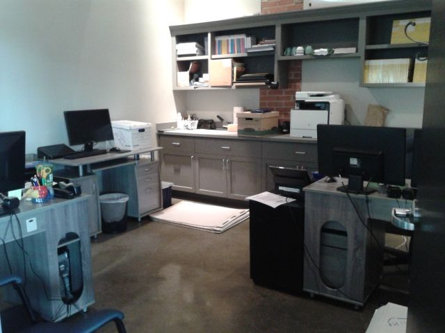 All moved in!  The rest is just adding some color and finding somewhere to stash those pesky flipcharts!