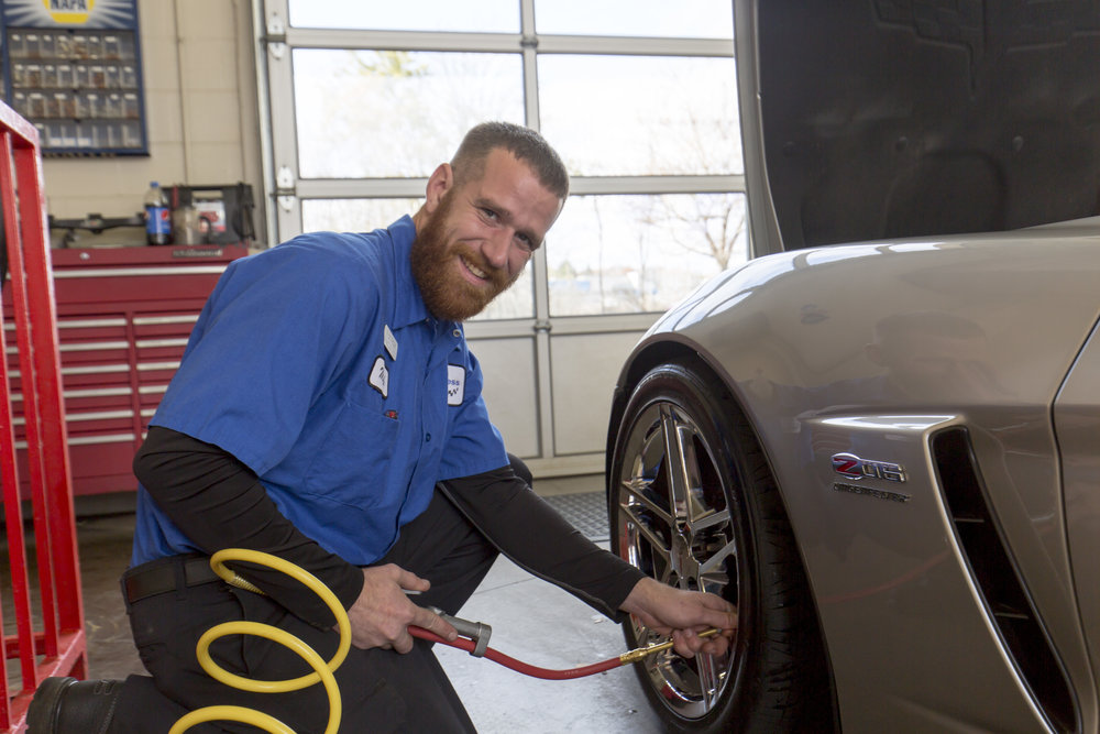 Employee Checking Tire Pressure For Oil Change In Wausau, WI