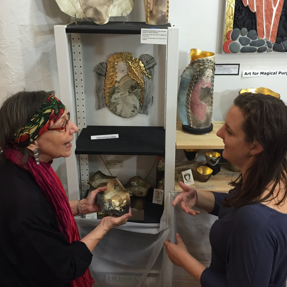 Syma with visitor at GOS Open Studio.jpg