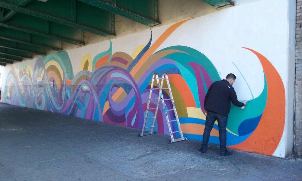 "Artist Miguel Del Real works on his improvisational mural on 4th Ave. ""Intersections"" was funded by NYC Department of Transportation's Art Program (2015)."