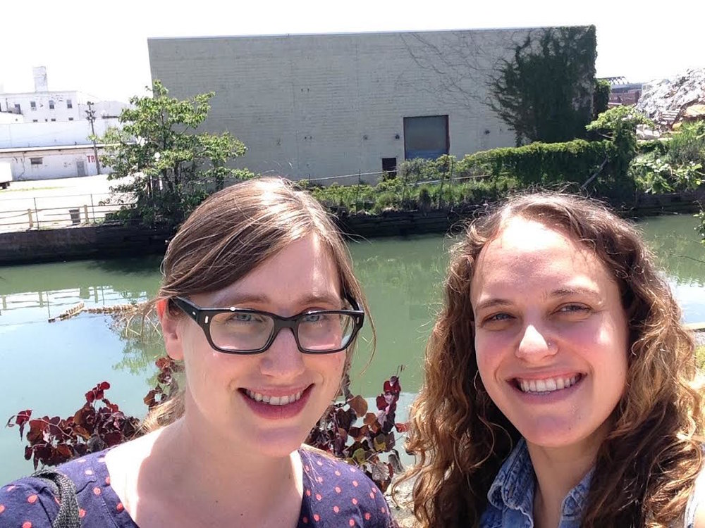 "Artists Julia Whitney Barnes and Ruth Hofheimer with the blank wall that will host their mural, ""Gowanus: Industry & Ecology"" (2015)."