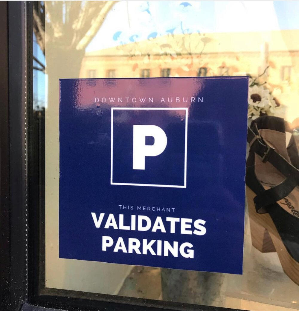 Look for this window cling for merchants who validate parking.